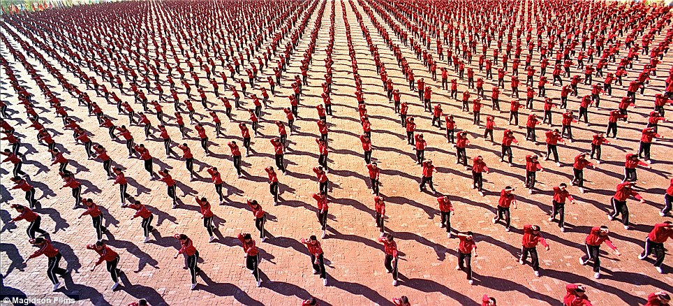 Discipline: Hundreds of students demonstrate their moves at the Tagou Wushu Academy in Zhengzhou, China